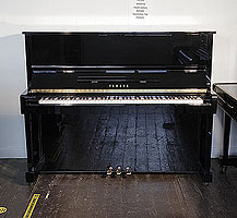 A 1993, Yamaha MC10A upright piano with a black case and polyester finish