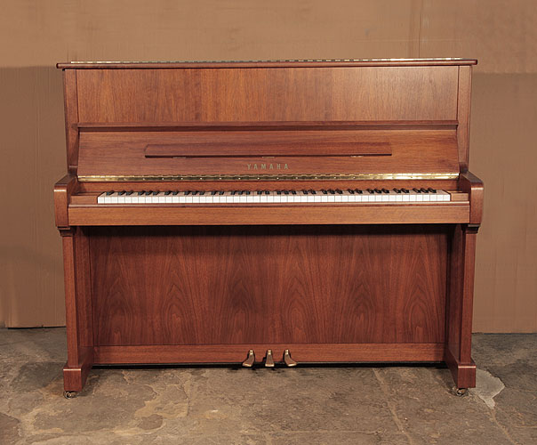 A 2005,  Yamaha   P121N Upright Piano For Sale with a  Walnut Case and Brass Fittings.