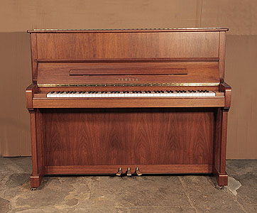 A 2005, Yamaha P121N upright piano with a walnut case and brass fittings. Piano has an eighty-eight note keyboard and three pedals.