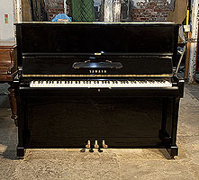 A 1974, Yamaha U1 upright piano with a black case and polyester finish
