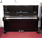 Piano for sale. A 1976, Yamaha U1 upright piano with a black case and polyester finish. Piano has an eighty-eight note keyboard and three pedals.