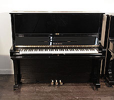 A 1980, Yamaha U3 upright piano for sale with a black case and brass fittings