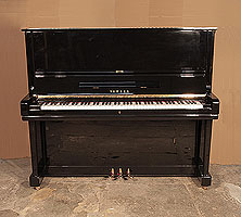 A 1956, Yamaha U3 upright piano for sale with a black case and brass fittings. Piano has an eighty-eight note keyboard and three pedals.