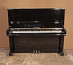 Piano for sale. A 1980, Yamaha U3 upright piano for sale with a black case and brass fittings. Piano has an eighty-eight note keyboard and three pedals.