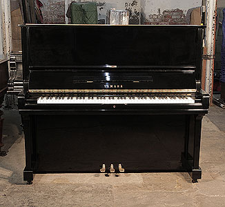 A 1974, Yamaha U3 upright piano with a black case and polyester finish. Piano has an eighty-eight note keyboard and three pedals.