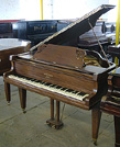 Piano for sale. An Eavestaff baby grand piano with a satin, mahogany case.