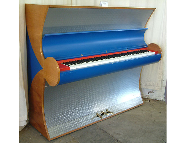 A  Besbrode upright piano specially commissioned for the Frankfurt Fair 2000. Uniquely finished with Aluminium and Leather