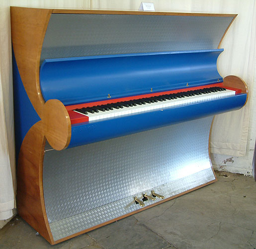 A 2000, Besbrode upright piano specially commissioned for the Frankfurt Fair 2000. Uniquely finished with Aluminium and Leather