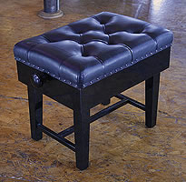 Besbrode Pianos Adjustable, Real Leather, Concert Piano Stool. Brass studs around cushion. Eight buttons on cushion.
