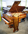 The Golden Age of Pianos Exhibition. A 1902, Bechstein Model C grand piano with a mahogany case, inlaid with a variety of woods in an Art Nouveau design of flowers and tendrils. This piano had one previous owner Julius Gutermann, a wealthy victorian industrialist.