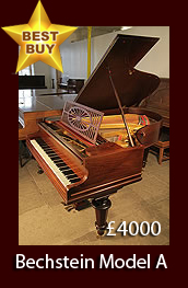 Antique, Bechstein Model A grand piano with a polished, rosewood case and turned legs.