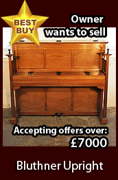 A 1903, Bluthner upright piano with a polished, oak case. Cabinet features  large, sculptural candlesticks and ornate, iron hinges. Piano comes with a matching piano stool. Piano has an eighty-eight note keyboard and  two pedals. Owner wants to sell and is now accepting offers over �7000. This is a fabulous opportunity to acquire a discounted Arts and Crafts, art cased piano.